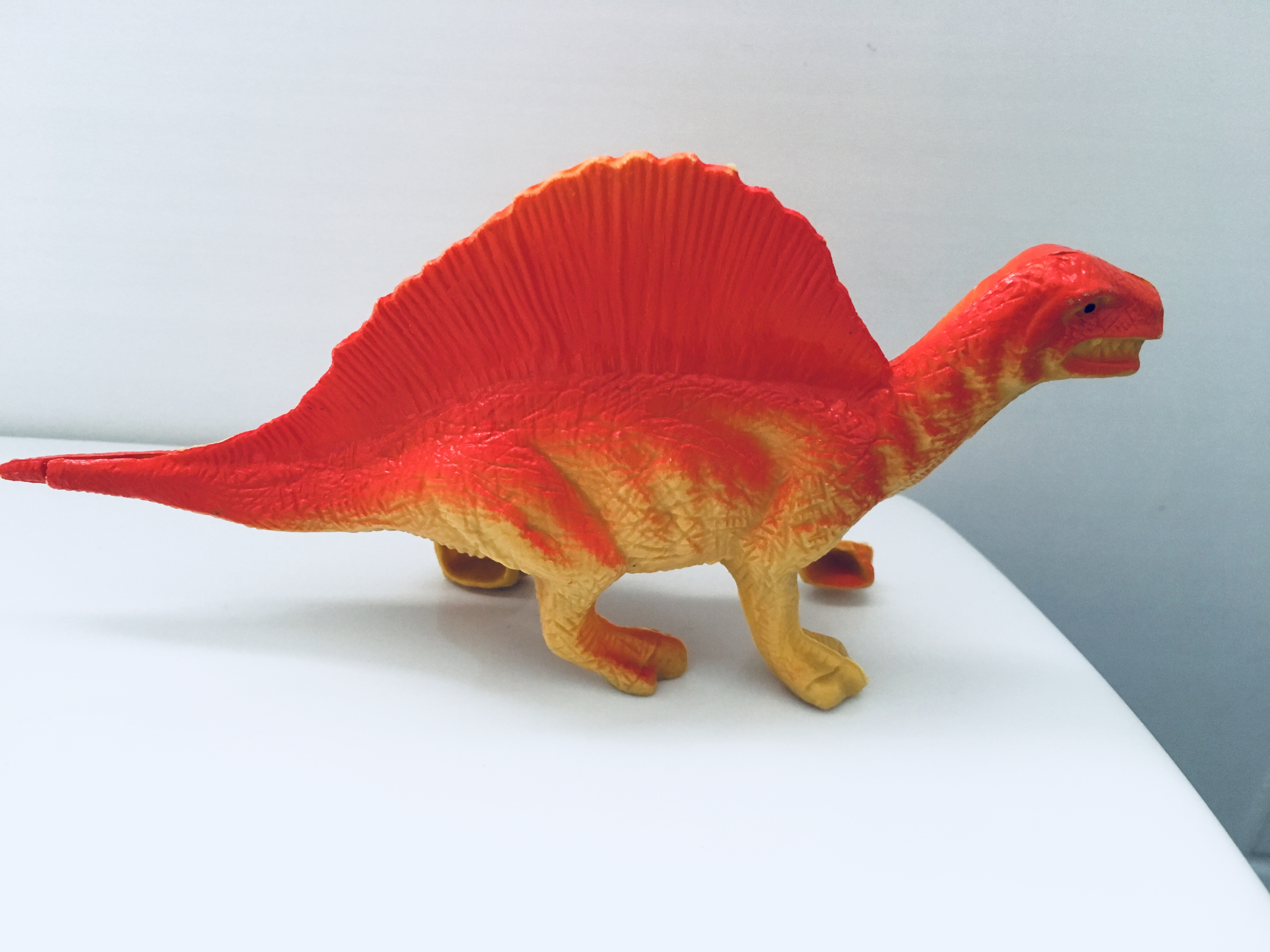 picture of a red plastic dinosaur